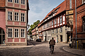 UNESCO World Heritage framework town Quedlinburg, man on bike in historic town center, Saxony-Anhalt, Germany