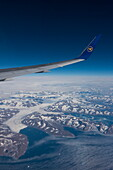 Aerial of wing and winglet of Condor B-767-300ER (D-ABUB) during flight DE 2062 from Frankfurt to Las Vegas with mountains and glacier on eastern coast of Greenland, above Greenland