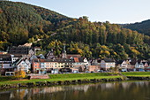 View across Main river to town and Burg Freudenberg castle in autumn, Freudenberg, near Miltenberg, Spessart-Mainland, Franconia, Bavaria, Germany