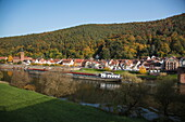 Freighter Solente on Main river passing town in autumn, Freudenberg, near Miltenberg, Spessart-Mainland, Franconia, Bavaria, Germany