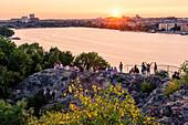 View from Soedermalm Skinnarviksparken, people enjoy the sunset, Stockholm, Sweden