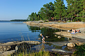 Bathers in the archipelago island Fiskehamn, Stockholm, Sweden