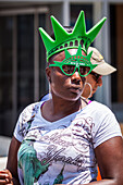 young black american girl wearing sunglasses and a styrofoam crown in the colors of the statue of liberty, financial district, downtown, manhattan, new york city, state of new york, united states, usa