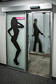 images of a woman and a secret agent on the doors to the restrooms in the restaurant at the summit of the schiltorn, the place where the film on her majesty's secret service was shot, schiltorn, piz gloria, bernese alps, canton of berne, switzerland