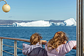 young girls, passengers aboard the astoria, discovery of the ice fjord, jakobshavn glacier, 65 kilometres long, coming from the inlandsis, sermeq kujalleq, ilulissat, greenland