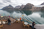 passengers on the ocean liner's deck to admire the landscape, astoria cruise ship, fjord in the prince christian sound, greenland