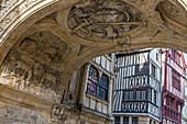 the good shepherd with his sheep, detail of the intrados beneath the vault of the renaissance arch holding the great clock, and half-timbered houses, rue du gros horloge, rouen (76), france