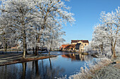 watermill of the fenderie (former forge) on the banks of the risle river, frost in the white trees of winter, rugles (27), france