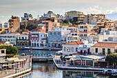 Voulismeni Lake, pedestrianised lakeside with cafes and Agios Nikolaos town, Lasithi, Crete, Greece, Europe