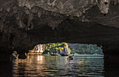 Vietnam, Ha Long Bay, the Tunnel Cave, kayak and small stroll boat (UNESCO World Heritage)