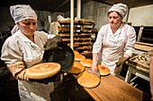 Workers of the Nikitin Kolkhoz bakery prepare bread, Ivanovka village, Azerbaijan, Bakery makes bread for local people, Children from school and kindergarden of Ivanovka eat only this bread, because it's made with natural products, We don't add any chemic