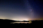 Starry sky over Laacher See, near Maria Laach, Eifel, Rhineland-Palatinate, Germany