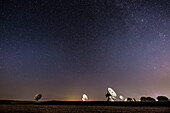 starry sky above the dish aerials of the earth station Raisting, Bavaria, Germany