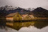 boathouses at lake Kochelsee, Bavaria, Germany