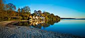 boathouses at the shoreline, Stegen at lake Ammersee, Bavaria, Germany