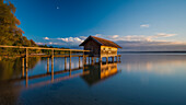 Warm light on a boathouse near Stegen at lake Ammersee, Bavaria, Germany