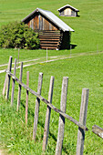 little barn and wooden fence near Gerold at lake Wagenbrüchsee, Bavaria, Germany