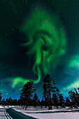 Northern lights above the ski tracks of Luosto, finnish Lapland