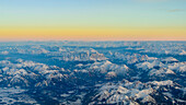 sunrise in the snow covered alps near the city of Kufstein, Tirol, Austria