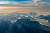 haze in the valleys arount the Zugspitze, aerial image,  Bavaria, Germany