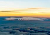 aerial shot of a lenticularis cloud and orange sky