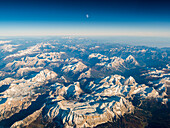 aerial picture during sunset with the moon above dolomites,  Venetia, Italy