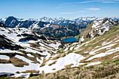 Germany, Bavaria, Alps, Oberallgaeu, Oberstdorf, mountain landscape with mountain lake and panorama, winter holidays, hiking, winter hiking trail, long distance hiking trail