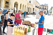 Shopping in Havana, vendor selling drinks with his street shop, historic town center, old town, Habana Vieja, family travel to Cuba, parental leave, holiday, time-out, adventure, MR, Havana, Cuba, Caribbean island