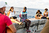 street music, street musicians and tourists at Malecon, historic town center, old town, Habana Vieja, Habana Centro, family travel to Cuba, holiday, time-out, parental leave, adventure, Havana, Cuba, Caribbean island