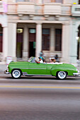 green oldtimer, cabriolet, tourists, driving along Malecon, taxi, historic town, center, old town, Habana Vieja, Habana Centro, family travel to Cuba, holiday, time-out, adventure, Havana, Cuba, Caribbean island