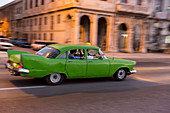 green oldtimer, tourists, driving along Malecon, taxi, historic town, center, old town, Habana Vieja, Habana Centro, family travel to Cuba, holiday, time-out, adventure, Havana, Cuba, Caribbean island