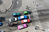 view from the roof of Hotel Saratoga on a crossroads, zebra crossing, horse-drawn carriage, oldtimer, cars, historic town, center, old town, family travel to Cuba, parental leave, holiday, time-out, adventure, Havana, Cuba, Caribbean island