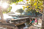 Children playing in the harbour, port of Playa Larga, fisherman boat, family travel to Cuba, parental leave, holiday, time-out, adventure, Playa Larga, Cuba, Caribbean island