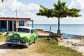 Oldtimer, old car at the beach of Playa Larga, family travel to Cuba, parental leave, holiday, time-out, adventure, Playa Larga, bay of pigs, Cuba, Caribbean island