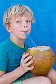 Boy, 6 years old, drinking from a coconut, Playa Larga, family travel to Cuba, parental leave, holiday, time-out, adventure, MR, Playa Larga, bay of pigs, Cuba, Caribbean island