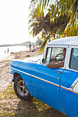 Oldtimer, old car on the beach of Playa Larga, family travel to Cuba, parental leave, holiday, time-out, adventure, Playa Larga, bay of pigs, Cuba, Caribbean island