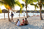 beautiful sandy beach and turquoise blue sea, Playa Rancha Luna, palm tree, family travel to Cuba, parental leave, holiday, time-out, adventure, Cienfuegos, Cuba, Caribbean island