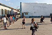 local people waiting for the tourists at Trinidad Bus Terminal, offering taxi or casa particulares, family travel to Cuba, parental leave, holiday, time-out, adventure, Trinidad, Cuba, Caribbean island