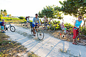 family on a bicycle tour, lonely coast road from La Boca to Playa Ancon, with beautiful small sandy beaches in between, at the beach, turquoise blue sea, family travel to Cuba, parental leave, holiday, time-out, adventure, near Trinidad and La Boca, Cuba,