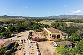 view from Manaca Iznaga tower, tour into the Valle de los Ingenios, formerly famous for sugarcane plantations, with a steam locomotive, family travel to Cuba, parental leave, holiday, time-out, adventure, near Trinidad, province Sancti Spiritus, Cuba, Car