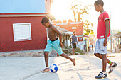 kids playing soccer in the city of Trinidad, family travel to Cuba, parental leave, holiday, time-out, adventure, Trinidad, province Sancti Spiritus, Cuba, Caribbean island