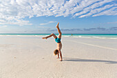 boy 6 years doing a handstand on the beach, tourists at the most beautiful beach in Cayo Guillermo, Playa Pilar, sandy dream beach, turquoise blue sea, swimming, family travel to Cuba, parental leave, holiday, time-out, adventure, MR, Playa Pilar, Cayo Gu