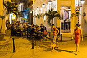 tourists, local people, woman in a red dress, outdoor seating at the restaurant Chacon 162, historic town, center, old town, Habana Vieja, Habana Centro, family travel to Cuba, holiday, time-out, adventure, Havana, Cuba, Caribbean island