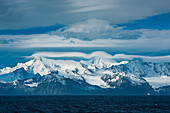 Glaciers and mountains with dramatic cloud formation, Gold Harbour, South Georgia Island, Antarctica