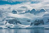Glaciers, mountains and thick cloud, Gerlache Strait, Graham Land, Antarctica