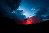 As daylight fades, the bright red lava of Mount Yasur becomes visible, Tanna Island, Vanuatu, South Pacific