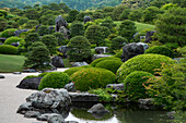 A zen garden invites the visitor to stroll through its serenely balanced beauty, Sakaiminato, Tottori, Japan, Asia