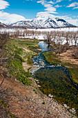 Hilltop view of a stream running through Nalychevo National Park, near Petropavlovsk-Kamchatsky, Kamchatka, Russia, Asia