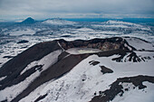Aerial of the caldera of Maly Semyachik stratovolcano with its acidic crater lake seen from helicopter, near Petropavlovsk-Kamchatsky, Kamchatka, Russia, Asia