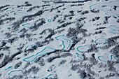 Aerial of snowy landscape with numerous thin lakes viewed from a helicopter, near Petropavlovsk-Kamchatsky, Kamchatka, Russia, Asia